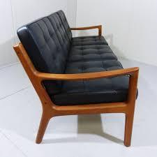 canape cuir et bois canapé senator en bois et cuir ole wanscher 1950 design market