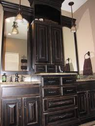 how to paint cabinets to look distressed black cabinets with faux distressing used 3 different colors of