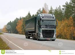 volvo semi models green volvo fh semi truck on the road in autumn editorial stock