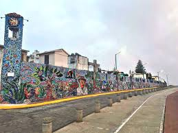 local artist adds magic to mexican town east falls local mexican mural wall tweaked