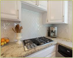 classic kitchen backsplash subway tile herringbone backsplash with plate and garnite