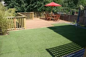 garden ideas with decking and grass raise vegetables on deck