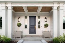 Front Door Planters by Black Front Door With Blue Moldings Transitional Home Exterior