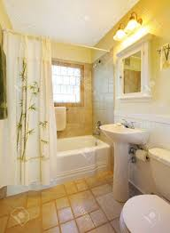 bathroom color ideas with beige tiles hanging lamps shower with