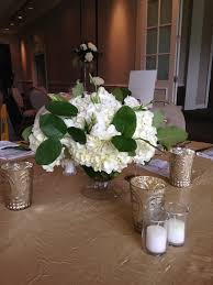 3 vases centerpieces simple fresh hydrangea arrangments short of 3 vases one with an