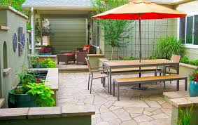 flagstone patio with stucco seat walls and metal trellis in