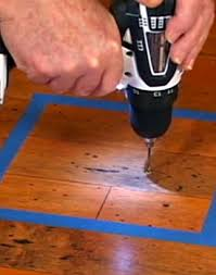 glue injection repair hardwood floors on concrete