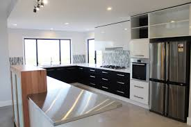 kitchen style black white cabinets stainless steel countertop