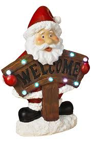 lighted holiday santa and snowman decorations with welcome sign