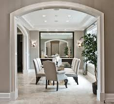 arch wall mirror dining room transitional with glass dining table