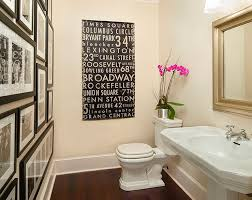 small powder bathroom ideas love the wall of photos in all matching black frames with black and