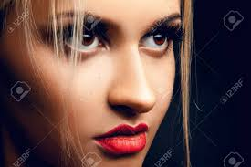 professional make up up portrait of gorgeous girl looking away brown