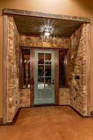 wood in interior decor archives architecture ventures wooden photos hgtv beautiful country entry with natural rock walls wood frame blue front door nautical