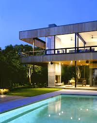 Minimalist House Design Excellent Evening View Of Blue Modern Swimming Pool Design In
