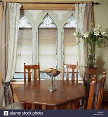 arts crafts style chairs and table in small dining room with beige