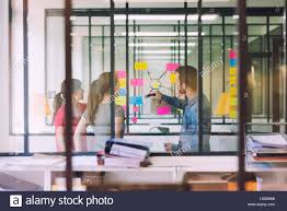 Post Office Casual Groupe Of Casual Business Working In Front Of Glass Wall