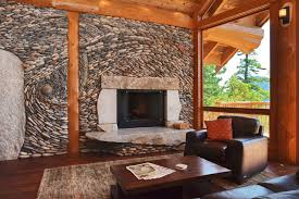 comfortable living room with stone veneer fireplace and wood