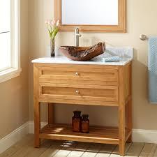 unstained maple wood small vanity in cream bathroom having single
