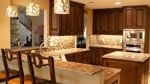 backsplash glass tile brown with brown cabinets colonial gold