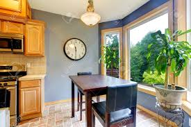 Dining Breakfast Table Near The Kitchen With Blue Walls And Green - Kitchen with breakfast table