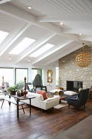 rosa beltran design exposed wood beams and white painted ceilings