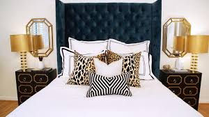 hollywood regency bedroom navy blue wingback bed with leopard pillows hollywood regency