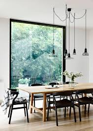 bright scandinavian dining room with roof windows and increased
