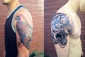 black and grey tiger roaring on shoulder by jeff norton