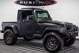 jeep wrangler matte black pre owned 2004 jeep wrangler rubitrux conversion flat black