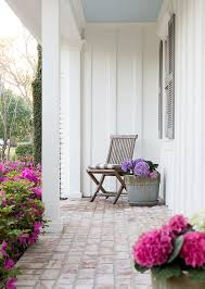 wraparound porch with red brick pavers transitional porch