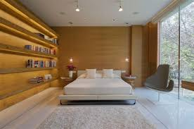bedroom with wooden wall design in home remodel with innovative