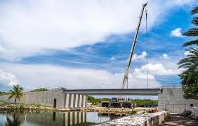 new festival green bridge at camana bay takes shape cayman compass