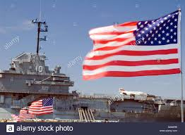 Navy Flag Meanings Us Naval Aircraft Carrier With Us Flag Stock Photo Royalty Free