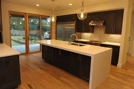 island with thick quartz top and waterfall edge kitchen ideas