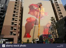 an artist paints a giant wall mural depicting a sumo wrestler on an artist paints a giant wall mural depicting a sumo wrestler on october 23 2015