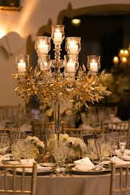 candelabra centerpieces decor candelabra centerpiece with greenery 2205063 weddbook