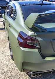 custom car tail lights matte green car with dark tail lights and spoiler stock photo