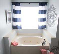 idea for curtains on our bathroom window above the tub like it a