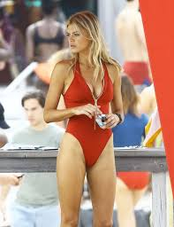 Yasmine Bleeth Butt - kelly rohrbach shows off her peachy behind as she slips into
