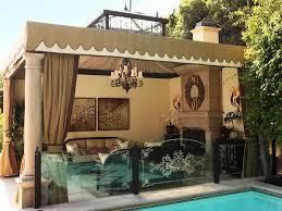 Outdoor Glass Room - sophisticated outdoor sitting room to make guest feel comfort