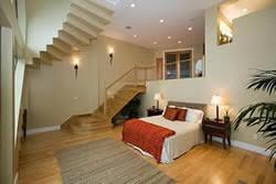 split level bedroom oak stairs leading to a unique split level master bedroom
