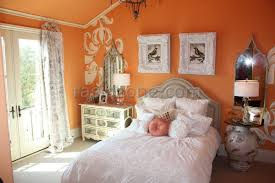 orange walls in a bed room interior design ideas