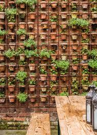 design sleuth vertical garden of terra cotta pots gardenista