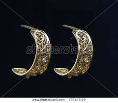 beautiful gold earrings gold earrings stock images royalty free images vectors