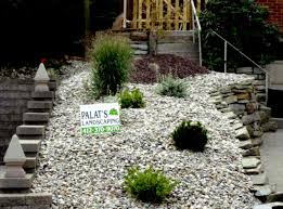 landscaping great designs with rocks and gravelsand green shrubs l