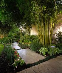 creative idea green bamboo garden with colorful flowers and