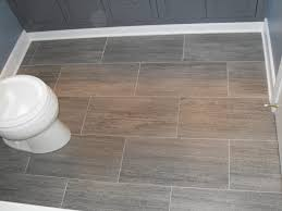 bathroom gray porceline tile flooring white toilet dark grey