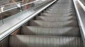 moving down in modern escalator escaltor escaltor moving