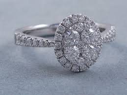 cluster engagement ring 0 83 ctw oval cluster engagement ring f vs