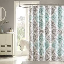 bathroom white door casing style with pattern shower curtains and